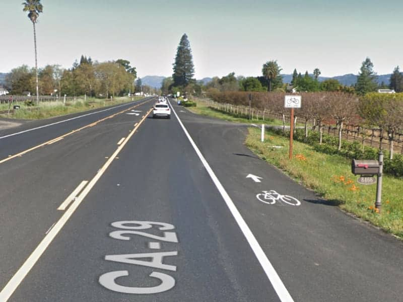 A view showing the bike lane adjacent to the traffic lane on highway 29 in Napa Valley.