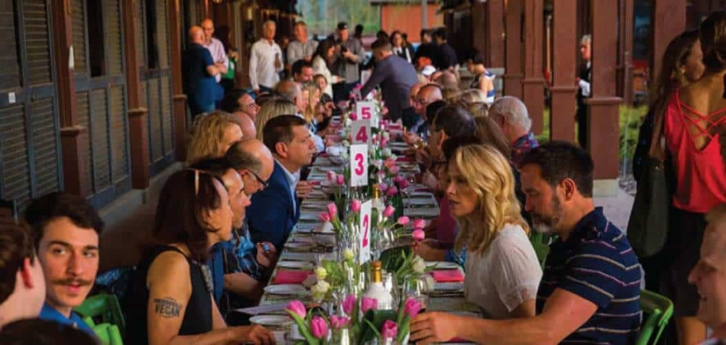 Guests seated at a long dining table at a special dinner during CampoVelo weekend